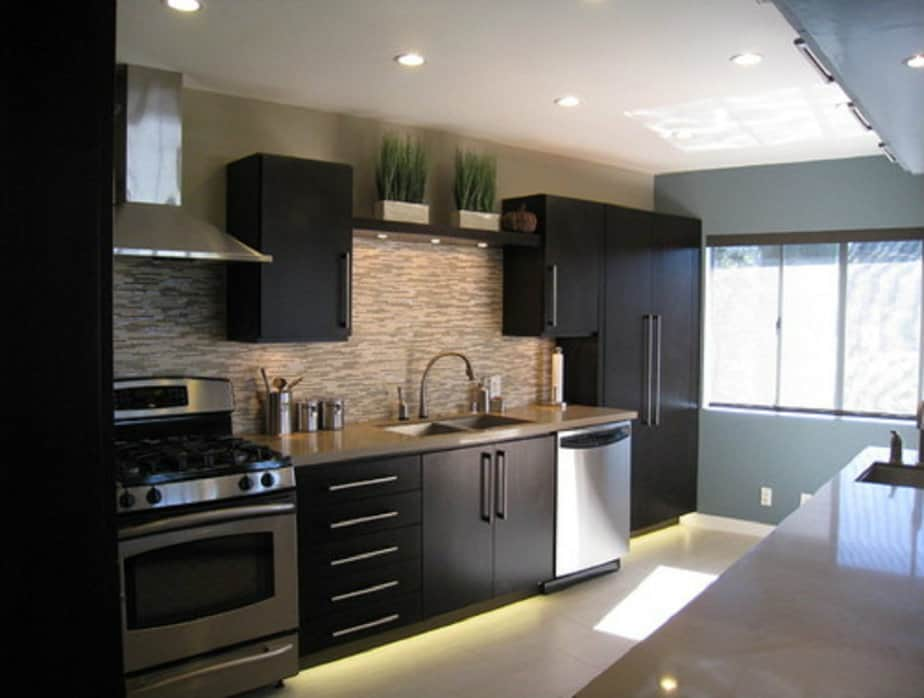 Kitchen decorating ideas black kitchen house interior for Modern kitchen furniture design